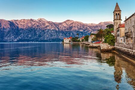 Evening in sea town on mountains background  Montenegro photo