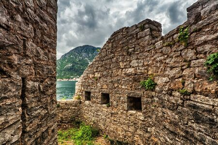 Old wall with windosw seaview in bad weather Stock Photo - 15829724