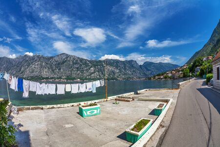 Wet clothes drying on the pier near the sea  Montenegro  Fish eye look Stock Photo - 16062902