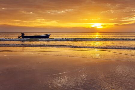 Boat on the beach at sunset in tide time  Stock Photo - 16063901