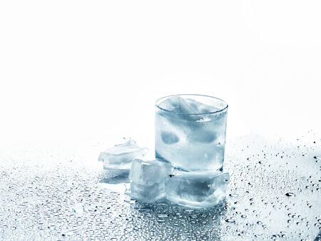 Glass with a drink and ice on a white background Stock Photo - 16217071