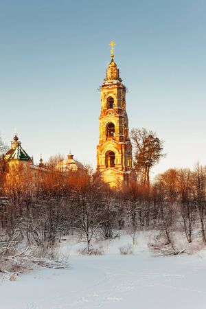 Beautiful winter sunset in the forest and church Stock Photo - 16217080