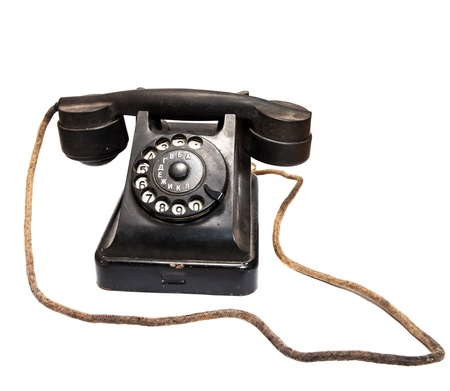 Old black phone on white background  Stock Photo - 16217065
