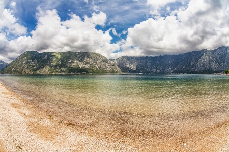 Sandy beach with sea and mountain views. fisheye look. Montenegro photo