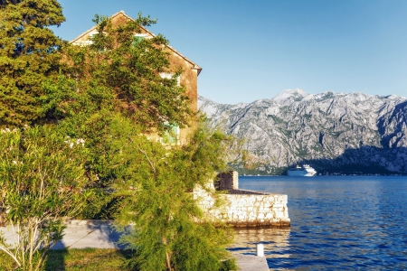 The old house with view on the sea and mountains. Montenegro Stock Photo - 16217095