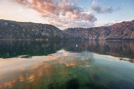 Sunset on the sea with the а foggy mountains. Montenegro Stock Photo - 16217089