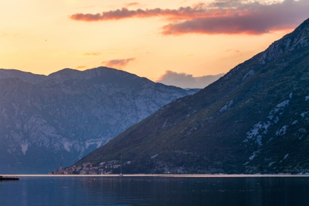 Sunset on the sea with the а foggy mountains. Montenegro Stock Photo - 16217087