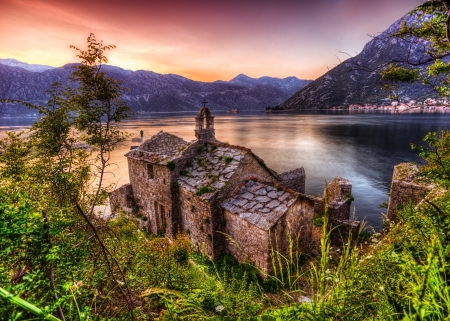 The old church overlooking the sea in bad weather in sunset time. Montenegro Stock Photo - 16451791
