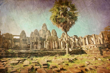 Ancient buddhist khmer temple in Angkor Wat complex in grunge and retro style, Cambodia Stock Photo - 16451826
