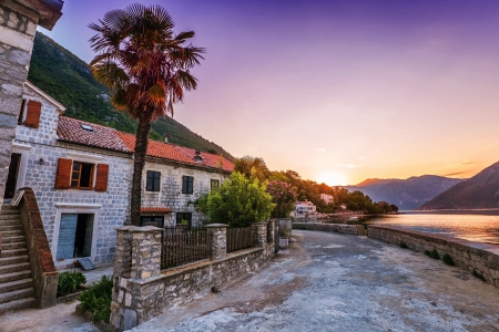 Evening in sea town on sunset and mountains background. Montenegro photo