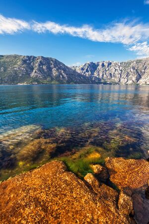 Stones beach with sea and mountain views.  Montenegro photo
