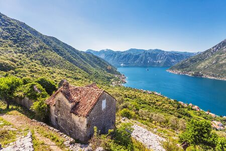 The old house with view on the sea and mountains  Montenegro Stock Photo - 16729313