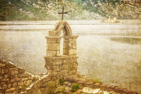 The old church overlooking the sea in bad weather in retro style  Montenegro Stock Photo - 16729310