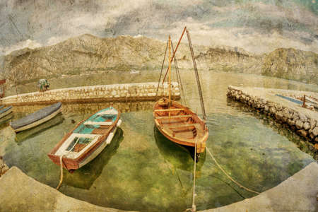 A small bay with boats in retro style  Kotor  Montenegro Stock Photo - 16729305