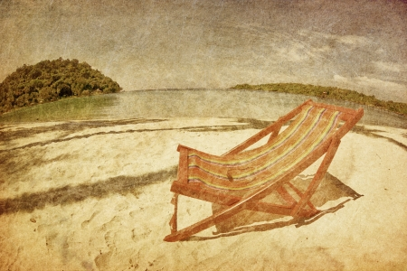 sun beach chair on shore near sea in grunge and retro style Stock Photo - 16856089