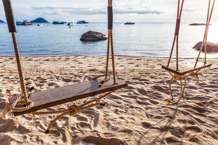 Swing on beautiful sunset at the beach Stock Photo - 16856072