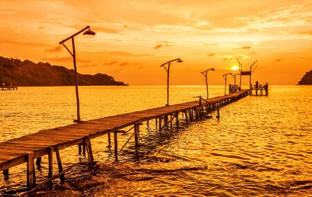Sunset over the sea  Pier on the foreground Stock Photo - 16942771