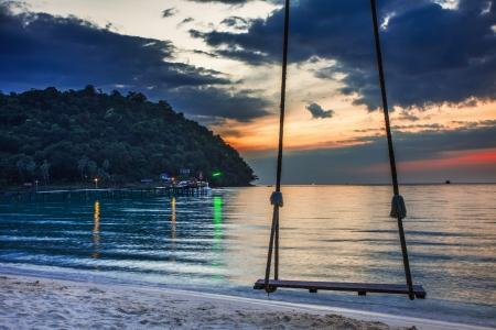 Swing on beautiful sunset at the beach Stock Photo - 17016693