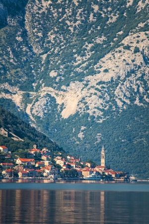 Evening in sea town on mountains background  Montenegro Stock Photo - 17013515