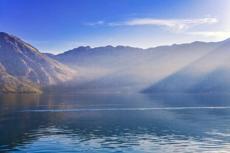 Early misty morning on the beach with sea and mountain views  Kotor bay  Montenegro Stock Photo - 17013504