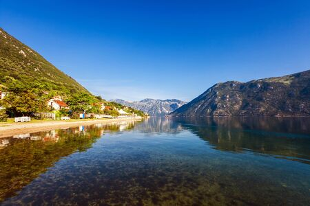 Early misty morning on the beach with sea and mountain views  Kotor bay  Montenegro Stock Photo - 17013507