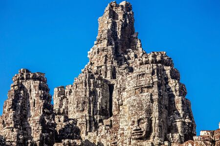 Faces of ancient Bayon Temple At Angkor Wat, Siem Reap, Cambodia  Stock Photo - 17195874