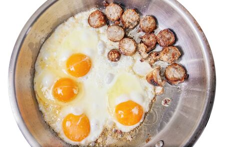 Frying pan with sausage slices and eggs  Stock Photo - 17703194