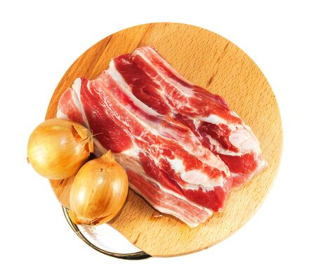 red raw meat and onion over white on wooden plate Stock Photo - 17703188