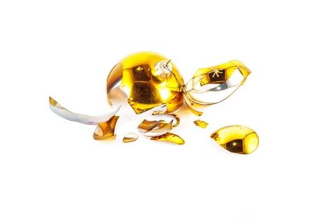 Pieces of broken yellow Christmas ball Stock Photo - 17703186