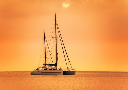 Yacht in the tropical sea at sunset  Stock Photo - 17703200