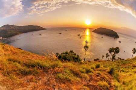 Panoramic view on sunset sea, small island, palms and boats  in fish-eye lense  Nature background  photo
