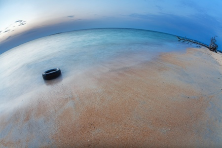 Before night on the white sand tropical beach with tire  Phuket  Thailand Stock Photo - 17956626
