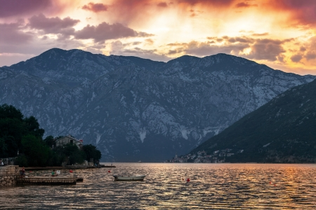 Sunset on the sea with the  foggy mountains  Montenegro Stock Photo - 18152109
