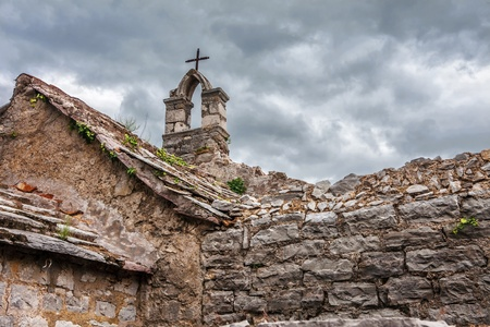 Stone old church under gloomy sky with clouds  Montenegro Stock Photo - 18152137