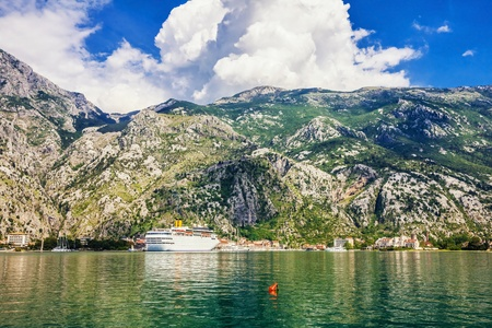 Tourist white cruise sea liner is sailing in rocky bay on the mountain background Stock Photo - 18152246