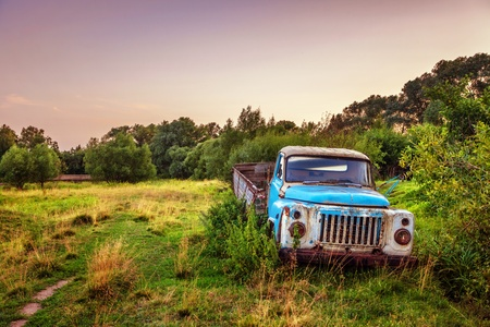 Old lorry in the field before sunset photo