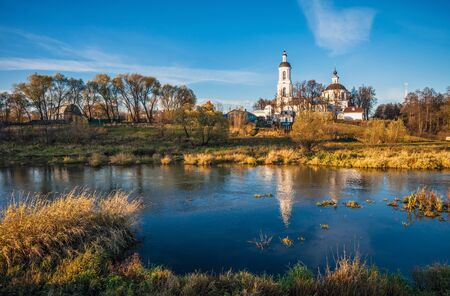 Summer panoramic landscape with river and church Stock Photo - 18345914