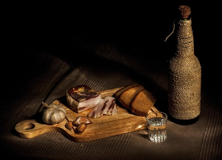 bacon night: Still-life with bacon, bread and vodka