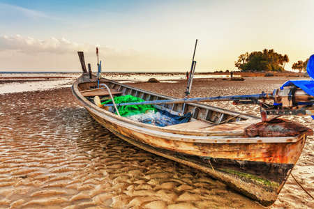Old Thai fishing boat at the beach. Phi Phi island. Thailand  photo