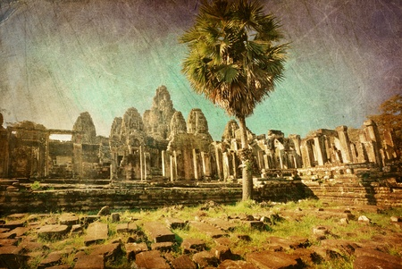 Ancient buddhist khmer temple in Angkor Wat complex in grunge and retro style, Cambodia photo