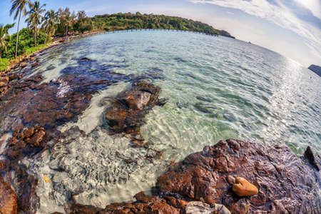 Beautiful tropical beach with  sea view, clean water & blue sky. Nature background fisheye view  Stock Photo - 18939144