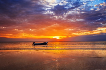 Boat on the beach at sunset in tide time. Stock Photo - 18910675
