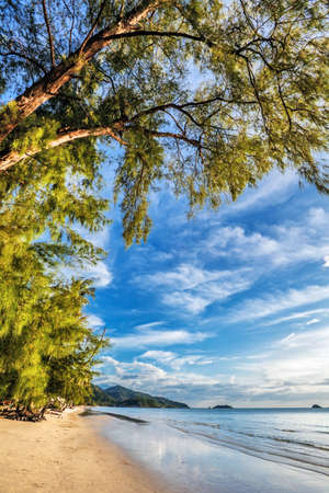 Beautiful tropical beach with  sea view, clean water & blue sky. Nature background Stock Photo - 18939145