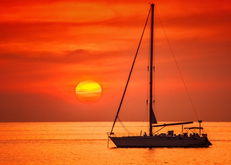 Sailing boat on a background of a beautiful sunset  photo