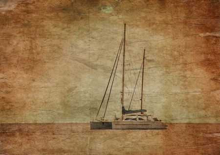Yacht in the tropical sea at sunset in grunge and retro style photo