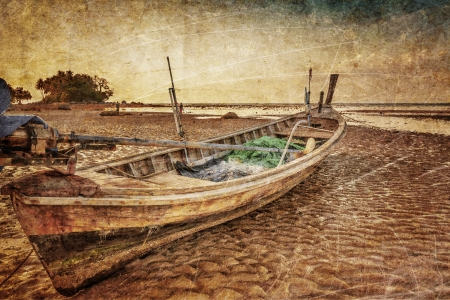 Old Thai fishing boat at the beach in grunge and retro style. Thailand  photo
