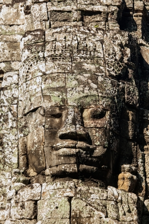 Faces of ancient Bayon Temple At Angkor Wat, Siem Reap, Cambodia  photo