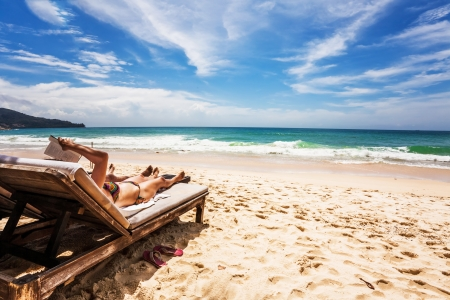 Relaxing and reading on the beach  Thailand Stock Photo