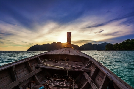 Moving at boat in the tropical sea to sunset   Thailand  photo