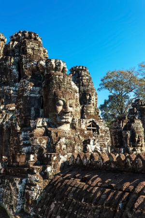 Faces of ancient Bayon Temple At Angkor Wat, Siem Reap, Cambodia  Stock Photo - 20195037